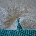 Torn bath towel