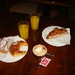 pastry and cappuccino and orange juice for breakfast