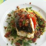 Main course Sea Bass on baked & grilled vegtables with olive oil dressing & herbs.....Yummy.