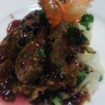 Rack of lamb with red wine green peppercorn sauce