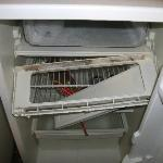 Broken and dirty shelf in the freezer