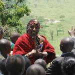 John enjoys the young audience at Nakuru