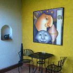 patio dining with artwork