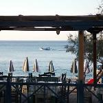 Early morning fishing boat passing by the hotel taverna