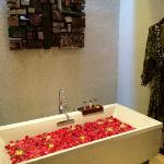 bathroom with flower bath setup