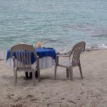 A romantic dinner on the beach for two.