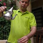 Abdou pouring mint tea