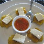Fried plantains with cheese and salsa