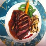 duck with blood orange ginger sauce, angolitti with spiced nuts and cherries