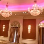 Beautiful chandeliers with color changing concave ceiling