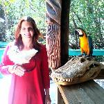 Jodi with Phantom and Capitan Jack sitting on a huge gator skull