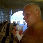 Enjoying the afternoon bar special - Banana Beach Bananarama Rum Punch.