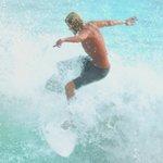 Surfer on Playa Camaronal, world class waves