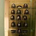 A collection of British Policemens helmets in reception