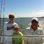 Captain Rob (right) with my sons in Estero Bay.