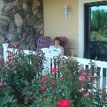 My wife reading her Nook on our private porch in a serene setting.