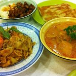 From top left clockwiseL Dry chicken curry, roti canai, chicken curry, laksa hor fun goreng