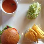 sampler lunch with burger, cold tomato soup, Caesar salad and onion dip with homemade potato chi