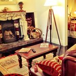 Gatehouse Cottage lounge with open log fire