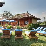Bon Nyuh Bungalows grassed area looking over the pool and over to the rice paddies