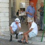 Playing chess on the steps of the Municipio, Gargnano