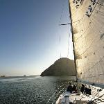 Raise the sails and head out to sea