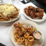 Flat Iron Bar & Grill fries, chicken wings, & calamari.