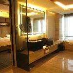 A very spacious bath room with tubs and showers and closet in one place
