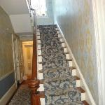 Staircase as you enter the Wedgewood Inn