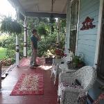 On porch of Wedgewood Inn