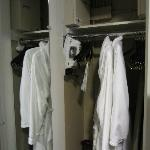 Wardrobe with bathrobes, ironing board