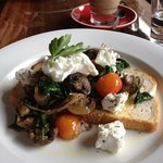 Vego Breakie with poached egg on a bed of spinach, mushrooms and marinated feta, served on toast
