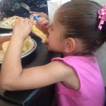 my grandbaby and her grill sandwich