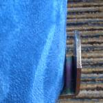 Metal bracket on bed is injury hazard