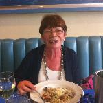 mum enjoying seafood pasta