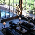 lobby with pool to the side and golf course behind