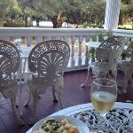 appatizers and wine spritzer on the front porch.