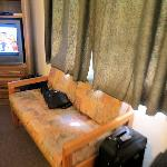 Sofa and TV in front of beds