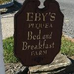 The sign in front of the farm