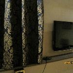 Deep blue damask curtains in bedroom