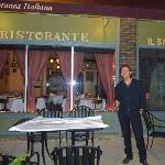 Antonino, the ownerc in front of his restaurant w/ it's big picture window.
