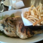 Half a garlic and thyme chicken with french fries.