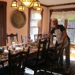 Lively innkeeper Cyd in dining room