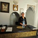 A warm smile awaits you on check in and other days. One of the owner's family. Very nice lady!