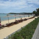 Hansar Samui beach area directly in front of hotel with start of Fisherman's Village Road inbetw