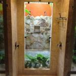 Indoor shower looks out to outdoor shower