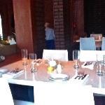 White bistro tables & brick walls inside L'Albatros