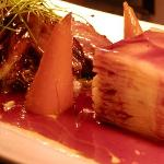 Spiced Plum Sauce Drizzled over layered potatoes & duck