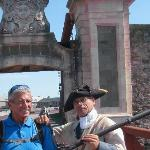 A guard shows me how to hold a musket