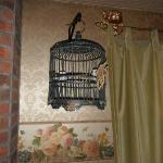 Neat birdcage and butterfly. Notice the curtain rod holders..Neat. Jenny Wade Room